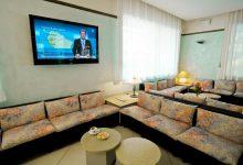Salotto con TV Maxischermo